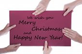Hands Holding Sign With Christmas Greetings