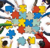 Group of People Forming Jigsaw Puzzles