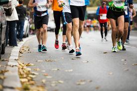 picture of foot  - Marathon running race people feet on autumn road - JPG
