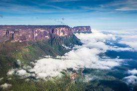 stock photo of canaima  - View from the Roraima tepui on Kukenan tepui at the fog  - JPG