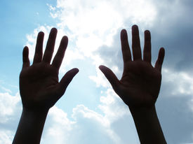 pic of hands up  - Two hands raised against the sky as in pray or surrender - JPG