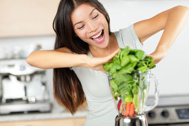 foto of blender  - Vegetable smoothie woman making green smoothies with blender home in kitchen - JPG