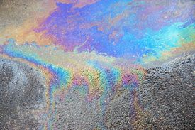 foto of petrol  - the abstract textured pattern of an oil or petrol slick on wet asphalt of the road - JPG