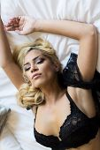 pic of laying-in-bed  - Pretty young woman laying on the bed - JPG