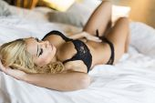 picture of laying-in-bed  - Pretty young woman laying on the bed - JPG