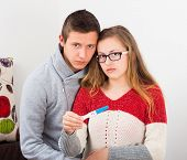 stock photo of teen pregnancy  - Teenage couple showing the result of their irresponsibility positive pregnancy test - JPG