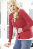 foto of human stomach  - Mature Woman Suffering From Stomach Pain At Home - JPG