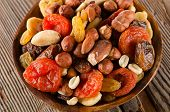 stock photo of mixed nut  - Healthy Mix nuts and dried fruits on a wooden background - JPG