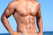 stock photo of abdominal muscle man  - sexy caucasian fit man posing in a beach - JPG