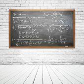 stock photo of formulas  - drawing formula on chalk board in room - JPG