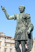 stock photo of emperor  - Ruins buildings and statue in the foro romano in Rome italy emperor cesare