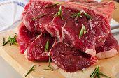 stock photo of porterhouse steak  - Raw Steak with Seasoning on a wooden board - JPG