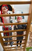 pic of pirate girl  - Two children are playing pirates at home