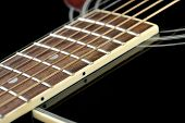 stock photo of fret  - Details of acoustic black guitar - JPG