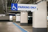 stock photo of handicap  - Blue Handicap Parking Only Sign For Disabled Drivers - JPG