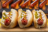 image of hot dog  - Three Hot Dogs with Mustard - JPG
