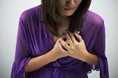 pic of dizziness  - Sick woman with heart attack chest pain health problem with blank area for text or copy space - JPG