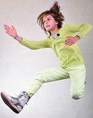 picture of sportive  - Portrait of a cute sportive cheerful happy girl with her hands up jumping and dancing - JPG