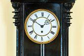 image of pendulum  - Closeup old big wooden pendulum clock hanging on wall - JPG