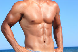 picture of body builder  - sexy caucasian fit man posing in a beach - JPG