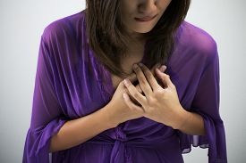 pic of breast-stroke  - Sick woman with heart attack chest pain health problem with blank area for text or copy space - JPG