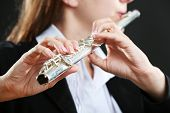 stock photo of transverse  - Musician playing flute - JPG