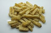 stock photo of potato chips  - Heap of fried potato chip sticks on white background - JPG