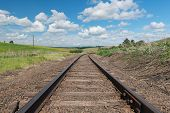 picture of track field  - Railroad tracks through fields of canola Colfax Washington - JPG
