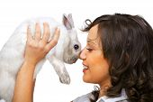picture of hand kiss  - Young woman kissing a rabbit in her hands isolated on white background - JPG