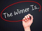 foto of winner  - Man Hand writing The Winner Is - JPG