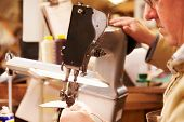 picture of stitches  - Shoemaker stitching leather in a workshop - JPG
