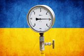 picture of air pressure gauge  - High pressure reading on gas wellhead isolated on flag Ukraine - JPG