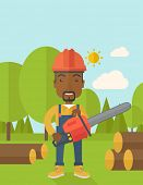 stock photo of man chainsaw  - A black Lumberjack with hard hat as protection cuts a tree by chainsaw under the heat of the sun - JPG