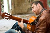 image of rockabilly  - man with guitar in the street - JPG