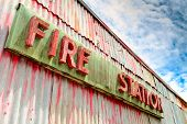 picture of fire-station  - Fire station banner hanging on the metal wall - JPG