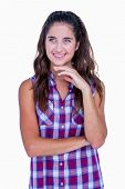 foto of thoughtfulness  - Thoughtful pretty brunette with fingers on chin on white background - JPG