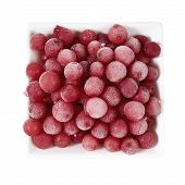 image of ice crystal  - Top view of frozen currants covered with ice crystals in a white porcelain bowl on white background - JPG