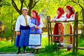 pic of national costume  - happy ukrainian family dressed in national costumes talking on the street