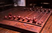 image of chessboard  - The game Ancient wooden chess standing on chessboard