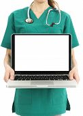foto of scrubs  - Doctor or nurse in green scrubs holding a laptop with white copy space on the display - JPG
