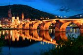 foto of old bridge  - Heidelberg Germany the Old Bridge at twilight reflected in the water of the Neckar river - JPG
