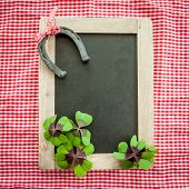 picture of horseshoe  - Vintage chalkboard with a lucky horseshoe and clover - JPG
