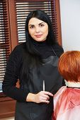 picture of beauty parlour  - Stylist portrait during cutting hair of a female client at the beauty salon - JPG