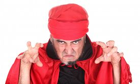 picture of sorcerer  - Hypnotist or sorcerer is doing hypnosis or magic with eyes and hands - JPG