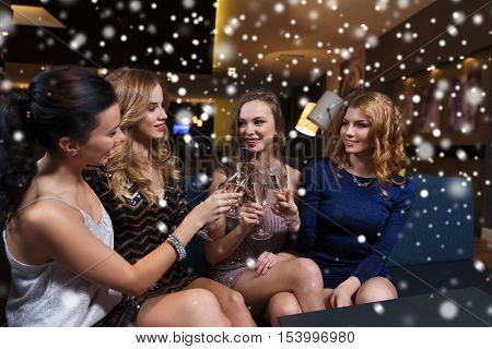 celebration, friends, bachelorette party and holidays concept - happy women clinking champagne glass