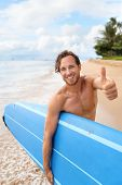 Surfer guy happy with surf surfing smiling doing thumbs up hand sign at camera after fun surf sessio poster
