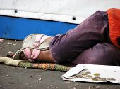 Child begging for money and sleeping on the street