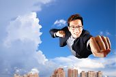 businessman fly in sky over the city