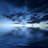 image of sea-scape  - Dark dramatic clouds over water - JPG