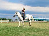 Girl Astride A Horse